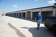 Chris Ludwig walks through his new storage unit facility in Fort Worth, Texas on July 14, 2016. (Cooper Neill for The New York Times)