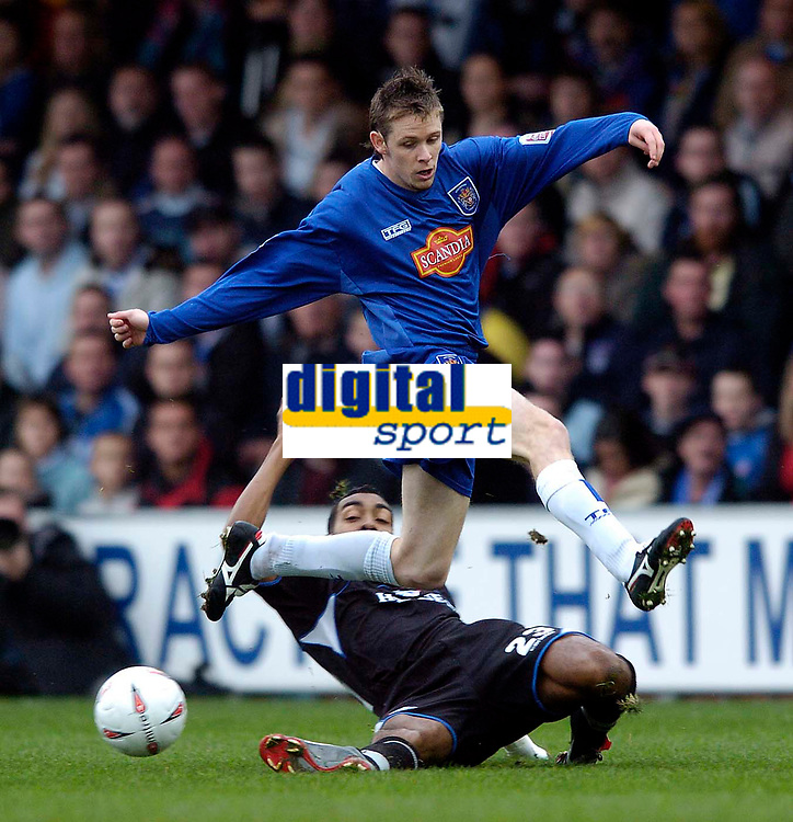 Fotball<br /> England 2004/2005<br /> Foto: SBI/Digitalsport<br /> NORWAY ONLY<br /> <br /> 30.10.2004<br /> Stockport County v Oldham Athletic<br /> Coca-Cola League One<br /> <br /> Stockport's Andy Welsh hurdles over a challenge from Oldham's Kevin Betsy