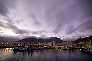 A night view of Cape Town harbor, the Victoria and Alfred Waterfront and Table Mountain, Cape Town, South Africa.