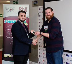 BNI Apollo (Lincoln) - Renewing member.  Pictured is, from left, BNI Apollo (Lincoln) chapter president Ashley Allison (Ryland Design Services) presenting Chris Vaughan (Chris Vaughan Photography) with a six year member badge.<br /> <br /> Picture: Chris Vaughan Photography<br /> Date: February 1, 2018