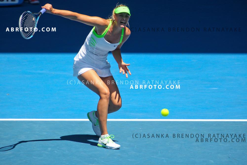 25 January 2012 : Maria Sharapova (RUS) in her quarterfinal match against Ekaterina Makarova (RUS) during Day 10 Quarterfinals of the Australian Tennis open grand slam event at Melbourne Park, Melbourne Australia.
