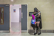 UNITED KINGDOM, London: 23 October 2015. <br /> Comic Con Feature.<br /> A cosplay fan dressed as a female Darth Vador waits for a friend outside of the Convention.<br /> Photo: Rick Findler / Story Picture Agency