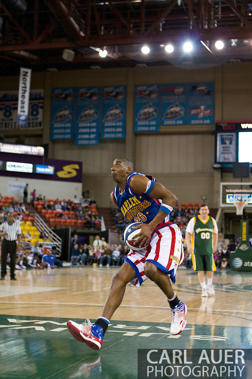 April 30th, 2010 - Anchorage, Alaska:  After stealing the ball from Anchorage Mayor Dan Sullivan, Hi-Lite Bruton explodes for a reverse dunk on Friday night at the George Sullivan Arena, named for the Mayor's father.
