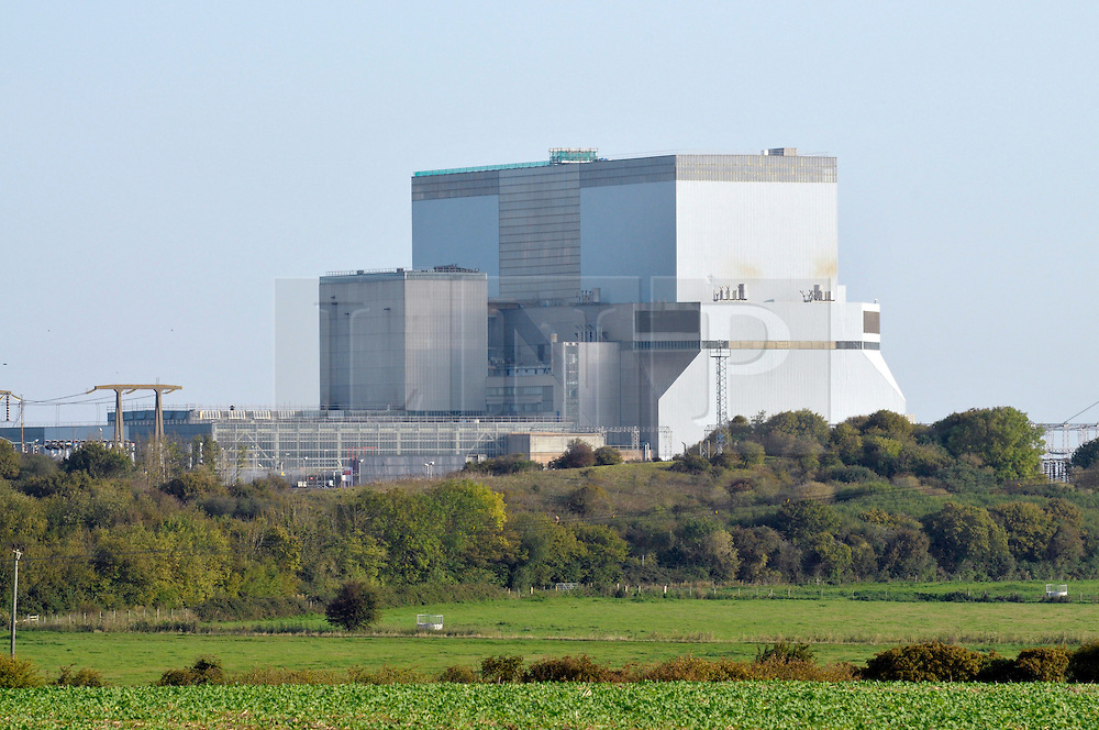 © Licensed to London News Pictures. 28/07/2016. Hinkley Point, Somerset, UK.  A final investment decision is expected today from French energy company EDF to go ahead with the building of Hinkley C nuclear power plant, the first nuclear power plant to be built in the UK for 20 years, which will be built next to the existing Hinkley A and B nuclear plants. FILE PICTURE dated 03 October 2011; Picture of the existing Hinkley B nuclear power station. Photo credit : Simon Chapman/LNP