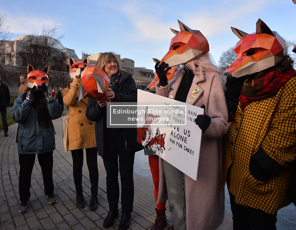 Green MSP Alison Johnstone joins campaigners wearing fox masks demonstrated outside the Scottish Parliament in Edinburgh ahead of the public consultation on the proposed bill to outlaw fox hunting.<br /> <br /> © Dave Johnston/ EEm