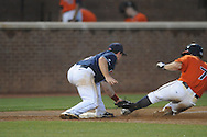 Virginia's John Barr (7) is safe at third as Mississippi's Zach Miller (1) makes the tag during an NCAA Regional game at Davenport Field in Charlottesville, Va. on Saturday, June 5, 2010.  Virginia won 13-7.