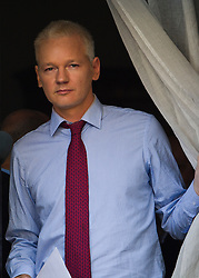 © Licensed to London News Pictures. 19/08/2012. Wikileaks founder Julian Assange emerging from the balcony before delivering a speech on the balcony of the Ecuador Embassy in London on August 19/08/2012. Assange, who faces arrest by British police if he leaves the building, took refuge in the embassy on June 19 to evade extradition to Sweden where he is wanted for questioning over alleged sexual misconduct. Photo credit : Ben Cawthra/LNP