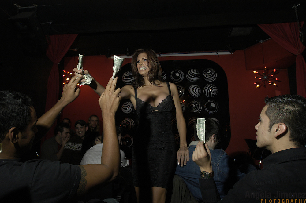DATE: 10/18/04<br />DESK: METRO<br />SLUG: CAYNE<br /><br />Transexual performer Candis Cayne, center, collects tips from audience members during her one-woman Candis Cayne Show at the Barracuda club in Chelsea, Manhattan.<br /><br />photo by Angela Jimenez for The New York Times<br />photographer contact 917-586-0916