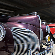 A 1941 Lincoln Continental in majestic - royal - purple. Chrome for miles and style that stands tall even today,  generations later.