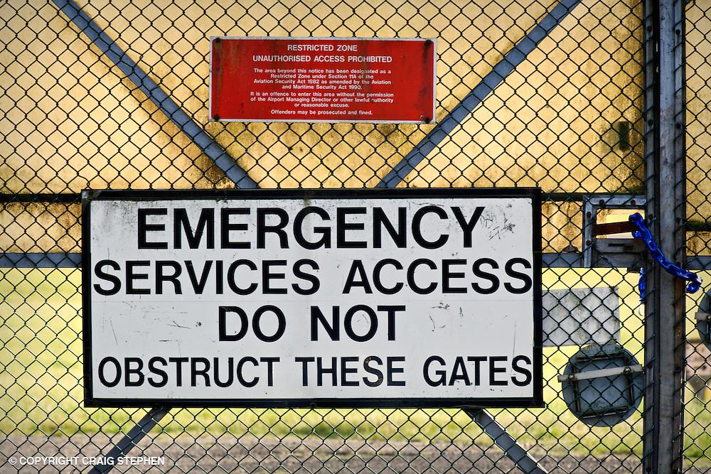 A security gate on the perimeter of Edinburgh airport, Scotland, UK