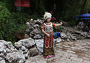 Posing in traditional clothing at Black Dragon Pool, in Lijiang, Yunnan, China; September, 2013.