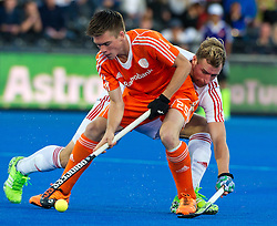 The Netherlands Thierry Brinkman is tackled by Dan Shingles of England. England v Netherlands  - Unibet EuroHockey Championships, Lee Valley Hockey & Tennis Centre, London, UK on 23 August 2015. Photo: Simon Parker