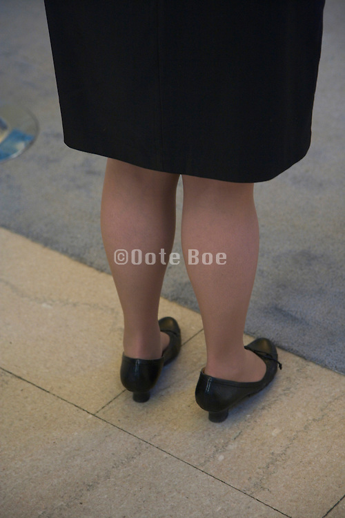 close up of businesswoman legs while standing