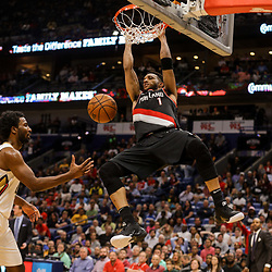 Mar 27, 2018; New Orleans, LA, USA; Portland Trail Blazers forward Evan Turner (1) dunks past New Orleans Pelicans forward Solomon Hill (44) and guard Jrue Holiday (11) during the second half at the Smoothie King Center. The Trail Blazers defeated the Pelicans 107-103. Mandatory Credit: Derick E. Hingle-USA TODAY Sports
