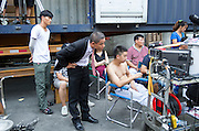 GUANGZHOU, CHINA - OCTOBER 02: (CHINA OUT)<br /> <br /> Chinese Obama Imitator<br /> <br /> Xiao Jiguo (L2) who is famous for imitating American President Obama watches the monitor during shooting in a comedy at a warehouse  on October 2, 2015 in Guangzhou, China. Xiao Jiguo, born in Sichuan province, was well-known as an imitator of American President Barack Hussein Obama after acting in a Chinese entertainment program. He became a star among the commercial events and acted in a comedy during the Chinas National Day Holiday in Guangzhou.<br /> ©Exclusivepix Media