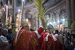 14 April 2019, Jerusalem: Procession during Palm Sunday service at the Church of the Holy Sepulchre, in the Old City of Jerusalem. Here, the head of the Roman Catholic Church in the Holy Land, titular Archbishop of Verbe and Apostolic Administrator of Jerusalem Pierbattista Pizzaballa.