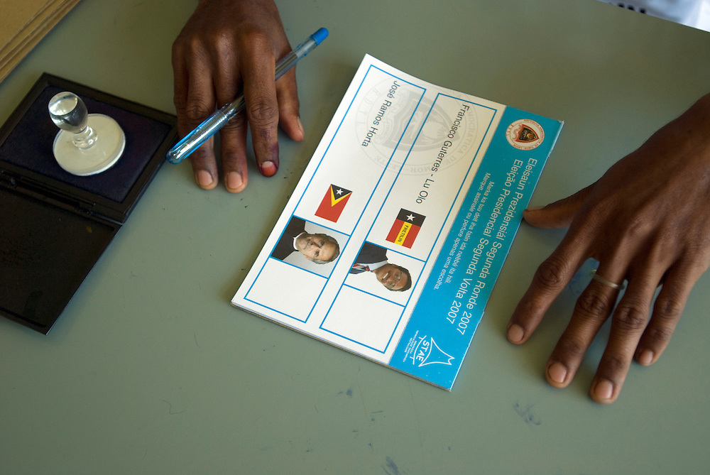 East Timor's Presidential Elections Ballot papers - The two candidates are Francisco Guterres - Lu Olo and Jose Ramos Horta. The red ink on the man's finger is proof that he has already cast a vote.
