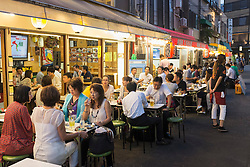 Small outdoor restaurants on street in the evening in Rokku entertainment district of Asakusa adjacent to SensoJi shrine in Tokyo Japan