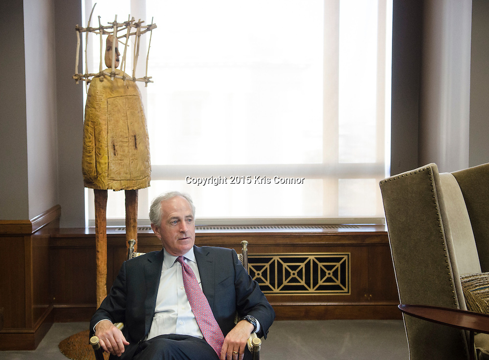 Senator Bob Corker(R-TN) speaks about the different pieces Tennessee art that line the walls of his Washington DC senate office in the Dirksen Senate Office Building in Washington DC on December 10, 2015. Including the piece behind him by artist Bruce Chapin from Corker's personal collection. Photo by Kris Connor