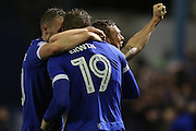 Lee Erwin of Oldham Athletic celebrates with his team mates Kallum Mantack and Paul Green of Oldham Athleticduring the EFL Sky Bet League 1 match between Oldham Athletic and Scunthorpe United at Boundary Park, Oldham, England on 18 October 2016. Photo by Simon Brady.