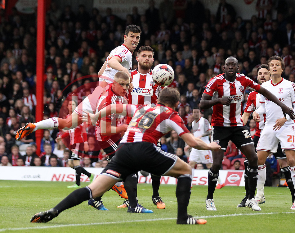 Middlesbrough's Daniel Ayala watches as his flicked header is cleared by Brentford's James Tarkowski - Photo mandatory by-line: Robbie Stephenson/JMP - Mobile: 07966 386802 - 08/05/2015 - SPORT - Football - Brentford - Griffin Park - Brentford v Middlesbrough - Sky Bet Championship