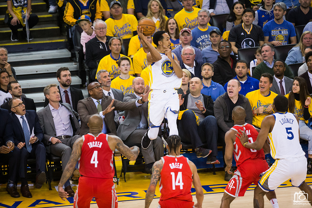 Golden State Warriors guard Shaun Livingston (34) saves the ball and falls into the stands against the Houston Rockets during Game 3 of the Western Conference Finals at Oracle Arena in Oakland, Calif., on May 20, 2018. (Stan Olszewski/Special to S.F. Examiner)