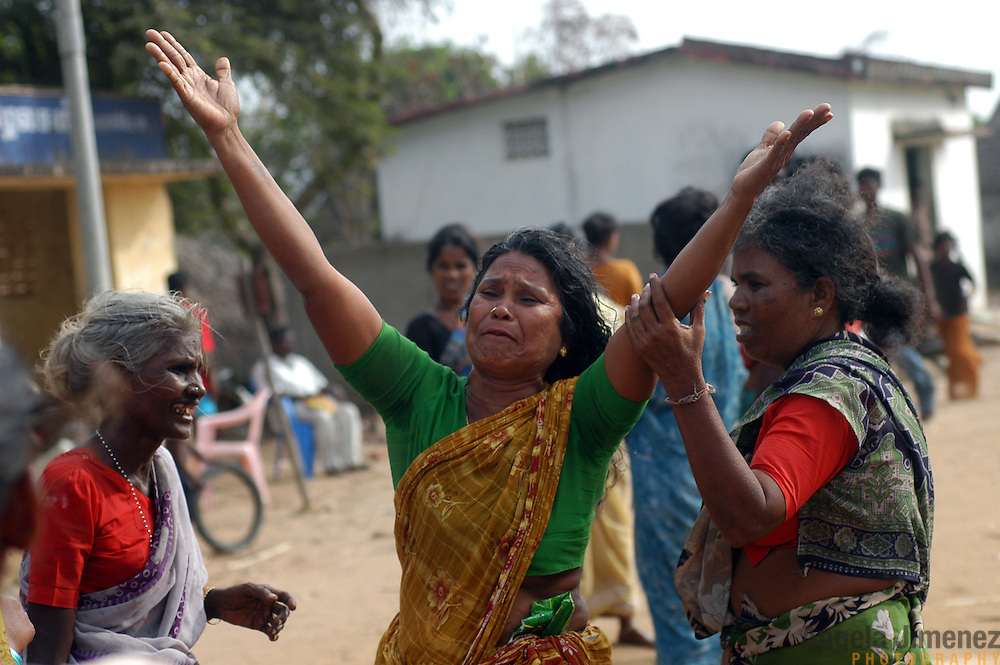 A woman cries after her son was beaten in a fight over the equitable distribution of saris and gas stoves donated by an NGO in the fishing village of Perumalpettai in Tamil Nadu, India on January 20, 2005. The area was struck by the Indian Ocean Tsunami on December 26, 2004, killing 37 of the villagers and destroying nearly all of their fishing boats. Generated by an earthquake on the ocean floor, the tsunami devastated the fishing industry along the southeastern coast of India.