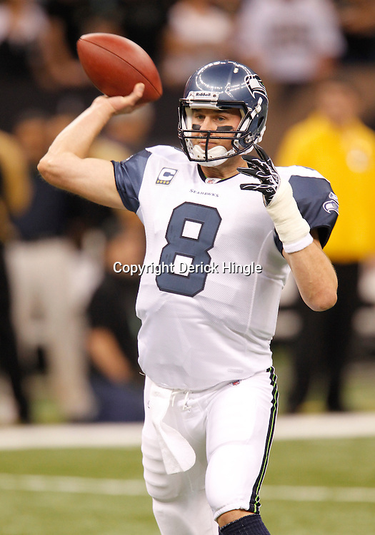 November 21, 2010; New Orleans, LA, USA; Seattle Seahawks quarterback Matt Hasselbeck (8) throws a pass during warm ups prior to kickoff of a game New Orleans Saints at the Louisiana Superdome. Mandatory Credit: Derick E. Hingle