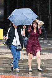 © Licensed to London News Pictures. 29/07/2018. London, UK.  People are caught in windy and heavy rain showers in central London near London Bridge station this morning.  Photo credit: Vickie Flores/LNP