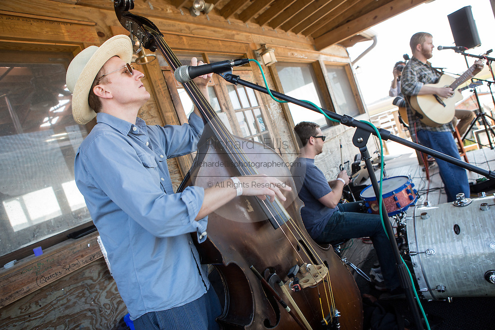 A country band plays music during Cook it Raw outdoor BBQ event on Bowen's Island October 26, 2013 in Charleston, SC.
