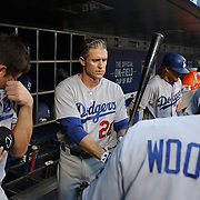 NEW YORK, NEW YORK - May 28:  Chase Utley #26 of the Los Angeles Dodgers preparing to bat in the dugout during the Los Angeles Dodgers Vs New York Mets regular season MLB game at Citi Field on May 28, 2016 in New York City. (Photo by Tim Clayton/Corbis via Getty Images)