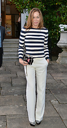 TARA PALMER-TOMKINSON attending Annabel Goldsmith's Summer party held at her home in Ham, Surrey on 10th July 2014.