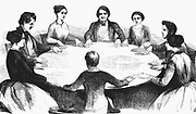 Spiritualist meeting in Leipzig. Communicating with spirits by table-turning. From  'L'Illustration' (Paris 1853). Wood engraving.