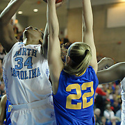 North Carolina Forward Xylina McDaniel (34) attempts a shot under the rim as Delaware Guard Lauren Carra (22) defends in the first half of a 2013 Round Two Women's NCAA tournament game against No. 6 Delaware Tuesday, March 26, 2013, at the Bob Carpenter Center in Newark Delaware.