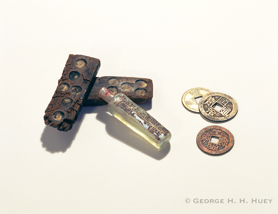 0307-1034 ~ Copyright: George H. H. Huey ~ Artifacts [coins, bottle and gaming pieces] beloning to Chinese working to construct the transcontinental railway in the late 1860's. Golden Spike National Historic Site, Utah.