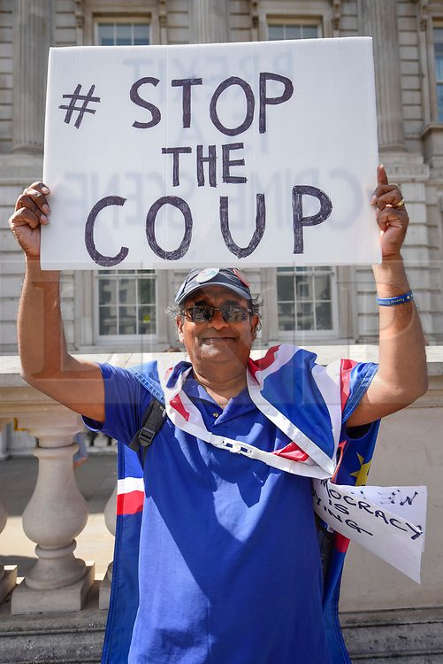 © Licensed to London News Pictures. 29/08/2019. LONDON, UK.  An anti-Brexit campaigner protests outside Cabinet Office the day after Boris Johnson, Britain's Prime Minister, announced the intention to suspend Parliament, under the mechanism of prorogation, in order to refine his Brexit plans.  Photo credit: Stephen Chung/LNP