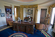 Aug. 27, 2013 - Florida, U.S. - <br /> <br /> Florida Ultra-Mansion Has Oval Office<br /> <br /> Tom Simpson stands near a scale model of the president's ''Resolute desk'' in the home's 900-square-foot recreation of the Oval Office. ...There is gaudy, and then there is the Mision Lago, one of this area's biggest mansions. The 23,000-square-foot estateon 11 acres of Lake Thonotosassa boasts some unique touches, including a few odes to Tampa Bay: A 1,500-square-foot home theater designed like the Tampa Theatre; a 900-square-foot recreation of the Oval Office; a sports lounge designed after the infield at Tropicana Field; and a ''rock-and-roll gallery'' of signed guitars and a mock Hollywood Walk of Fame. If all that sounds too cheesy, you can still enjoy the six bedrooms, 12 bathrooms, seven-car garage or 5,000-square-foot courtyard. A Tampa luxury builder spent three years on it, and it just took top honors as the best one-of-a-kind custom home priced over  million at the recent Southeast Building Conference. We'll be some of the first people inside. <br /> ©Exclusivepix
