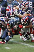 SEATTLE - NOVEMBER 28:  Running back Shaun Alexander #37 of the Seattle Seahawks gets gang tackled by a host of Buffalo Bills defenders. Alexander was held in check, rushing for only 39 yards on 13 carries against the Bills at Qwest Field on November 28, 2004 in Seattle, Washington. The Bills defeated the Seahawks 38-9. ©Paul Anthony Spinelli *** Local Caption *** Shaun Alexander