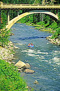 Idaho, Highway 55. Rainbow Bridge over the North Fork of the Payette River with rafters in water.