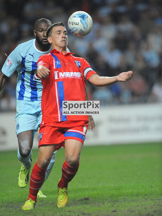 Gillinghams Cody McDonald Attacks Coventrys Defence Coventry City v Gillingham, League One, Back at the Ricoh Stadium for First Time, after playing at Six Fields Northampton.<br /> Friday 5th September 2014