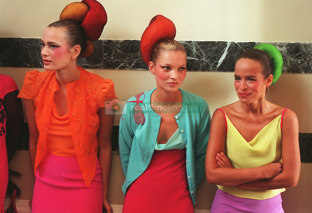 "PA NEWS PHOTO 26/9/97  SUPERMODEL KATE MOSS (CENTRE) WITH JADE JAGGER (RIGHT) DAUGHTER OF ROCK GROUP ""ROLLING STONES"" FRONTMAN MICK JAGGER TAKE A BREAK DURING THE LONDON FASHION WEEK. THEY WERE MODELLING FOR MATTHEW WILLIAMSON DESIGNS."
