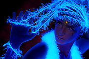 Young Girl with glowing string and jewel.Black light