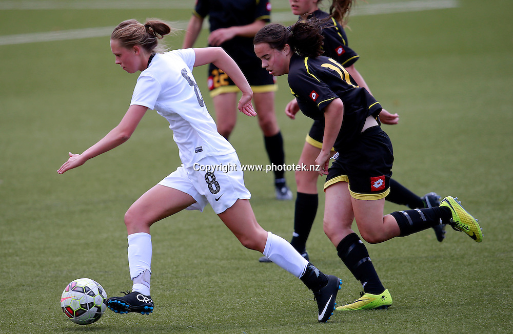 NZF's Daisy Cleverley gets the edge on her opponents. ASB Womens League Preliminary Final, NZF Development v Capital Football, QBE Stadium, Auckland, Sunday 30th November 2014. Photo: Shane Wenzlick