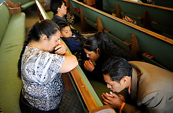 In an airy, open sanctuary lit by street-level stained glass, congregants pray and sing through an early morning Easter Sunday service at Cristo La Roca Church in East Salinas.