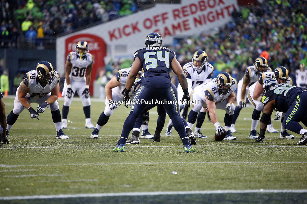 Seattle Seahawks middle linebacker Bobby Wagner (54) is set against the St. Louis Rams offense during the 2015 NFL week 16 regular season football game against the St. Louis Rams on Sunday, Dec. 27, 2015 in Seattle. The Rams won the game 23-17. (©Paul Anthony Spinelli)