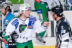 Tomi Mustonen (HDD Tilia Olimpija, #21) talking to linesman during ice-hockey match between HDD Tilia Olimpija and EHC Liwest Black Wings Linz in 19th Round of EBEL league, on November 7, 2010 at Hala Tivoli, Ljubljana, Slovenia. (Photo By Matic Klansek Velej / Sportida.com)