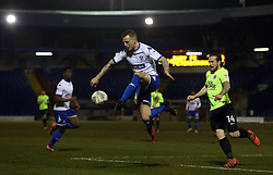 Peter Clarke of Bury controls the ball away from Jack Marriott of Peterborough United - Mandatory by-line: Joe Dent/JMP - 13/03/2018 - FOOTBALL - Gigg Lane - Bury, England - Bury v Peterborough United - Sky Bet League One