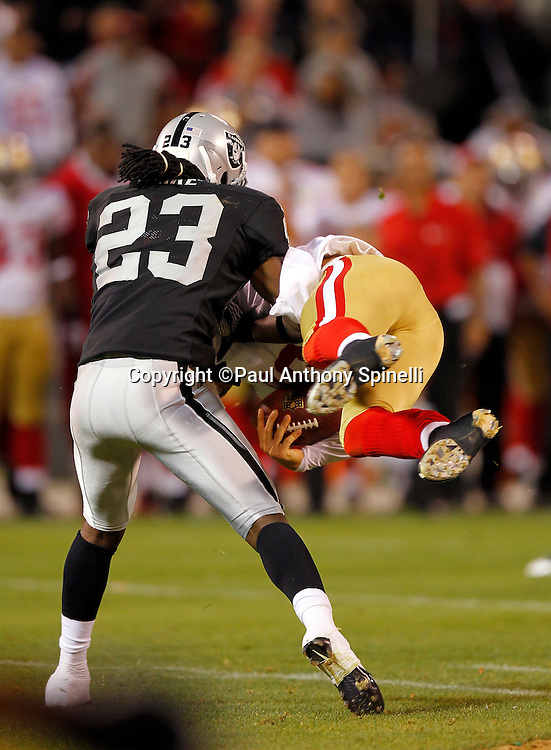 San Francisco 49ers quarterback David Carr (5) goes airborne and gets upended by Oakland Raiders cornerback Jeremy Ware (23) during the NFL preseason week 3 football game against the Oakland Raiders on Saturday, August 28, 2010 in Oakland, California. The 49ers won the game 28-24. (©Paul Anthony Spinelli)