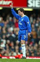 Photograph: Scott Heavey.<br /> Chelsea v Portsmouth. FA Barclaycard Premiership. 28/12/2003.<br /> Wayne Bridge lets the fans know the scoreline