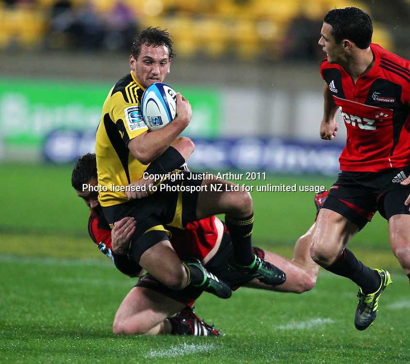 Aaron Cruden gets tackled by a Crusaders defender.Super15 rugby union match - Crusaders v Hurricanes at Westpac Stadium, Wellington, New Zealand on Saturday, 18 June 2011. Photo: Justin Arthur / photosport.co.nz